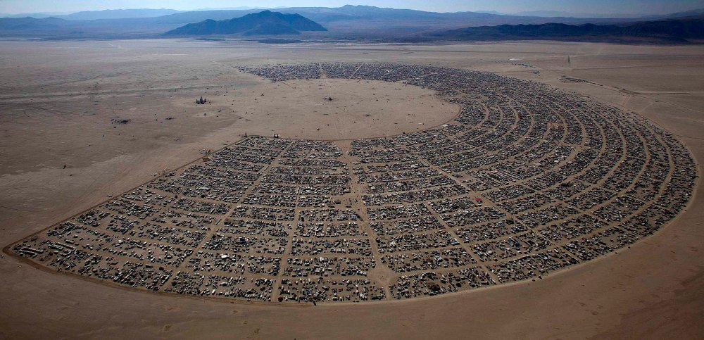 """Aerial view of the Burning Man """"Rites of Passage"""" arts and music festival in the Black Rock desert of Nevada"""